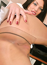 Awesome secretary in silky pantyhose eagerly showing what's under her skirt
