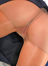 Blonde secretary in shiny tights using whatever's possible to stroke pussy